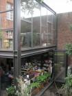 Openschuifbare wand aan plantenruimte.  Hoogrendementsglas (meer info stalen schrijnwerk zie downloads: pdf)