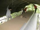 Hout langs de buitenkant voorzien van dampscherm en houtvezelplaten isolatie